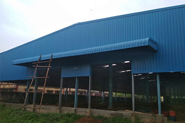 PEB warehouse finished look with Colour Coated Steel Sheets
